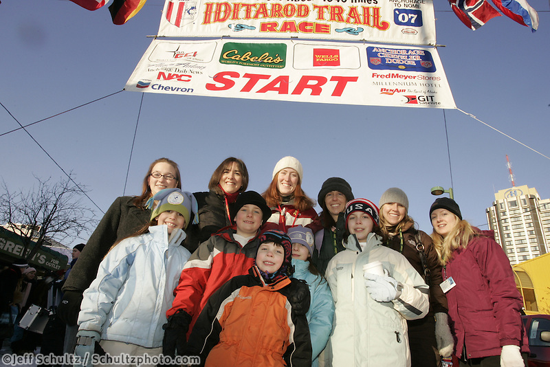 "March 3, 2007   Honorary ""Wives of Servicemen serving in Iraqi"" pose with their children during the Iditarod ceremonial start day in Anchorage"