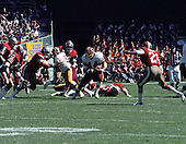 Washington Redskins running back John Riggins (44) carries the ball behind a block by center Jeff Bostic (53) during the game against the San Francisco Forty-Niners at RFK Stadium in Washington, D.C. on October 4, 1981. The Forty-Niners won the game 30 - 17.<br /> Credit: Howard L. Sachs / CNP