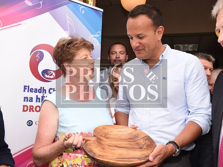 Lolo Robinson makes apresentation to An Taoiseach leo Varadkar at Fleadh Ceoil na hEireann. Photo:Colin Bell/pressphotos.ie