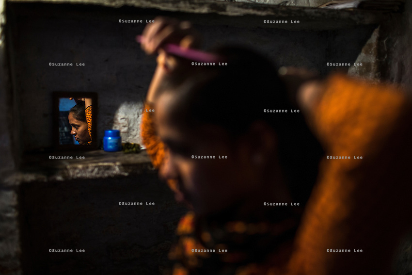 Saroj, a rescued girl under Guria's witness protection program while fighting her case in court, goes about her daily life in hiding with her mother and father in a safe house in Uttar Pradesh, India on 16 November 2013.