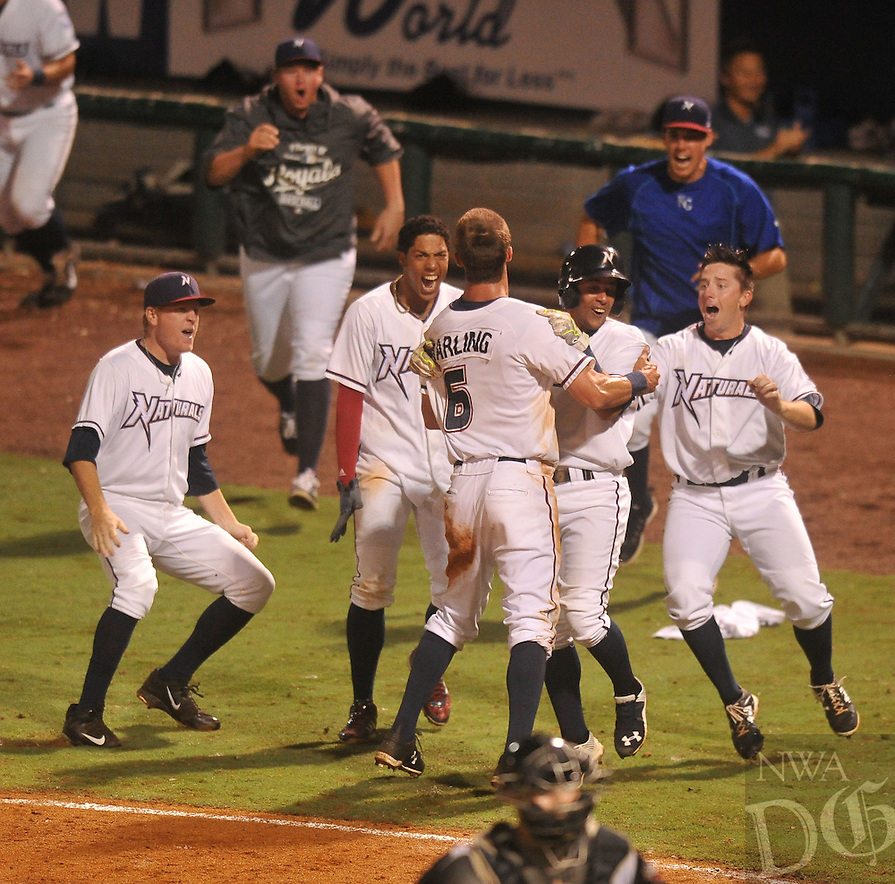 NWA Democrat-Gazette/MICHAEL WOODS &bull; @NWAMICHAELW<br /> Naturals baserunner Bubba Starling (6)  celebrates with teammates after scoring the winning run in the bottom of the 9th inning Wednesday September 9, 2015, as they beat the Arkansas Travelers to take a 1-0 lead in the series at Arrest Ballpark in Springdale.