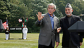 U.S. President George W. Bush (L) and Afghan President Hamid Karzai shake hands after a joint press conference in Camp David Maryland, USA on Monday 06 August 2007. Karzai's two-day visit to the Presidential mountain retreat included discussions of trouble at home, including a hostage crisis and a resurgent Taliban.