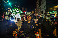 NEW YORK, NEW YORK - MAY 31: Police officers face off against protesters on May 31, 2020 in New York. Protests spread across the country in at least 30 cities in the United States. USA For the death of unarmed black man George Floyd at the hands of a police officer, this is the latest death in a series of police deaths of black Americans (Photo by Pablo Monsalve / VIEWpress via Getty Images)