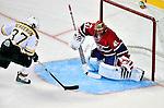 24 September 2009: Montreal Canadiens' goaltender Jaroslav Halak has his eye on Boston Bruins center Patrice Bergeron in an overtime shootout at the Bell Centre in Montreal, Quebec, Canada. Bergeron scored as the Bruins edged out the Canadiens 2-1in a pre-season matchup. Mandatory Credit: Ed Wolfstein Photo