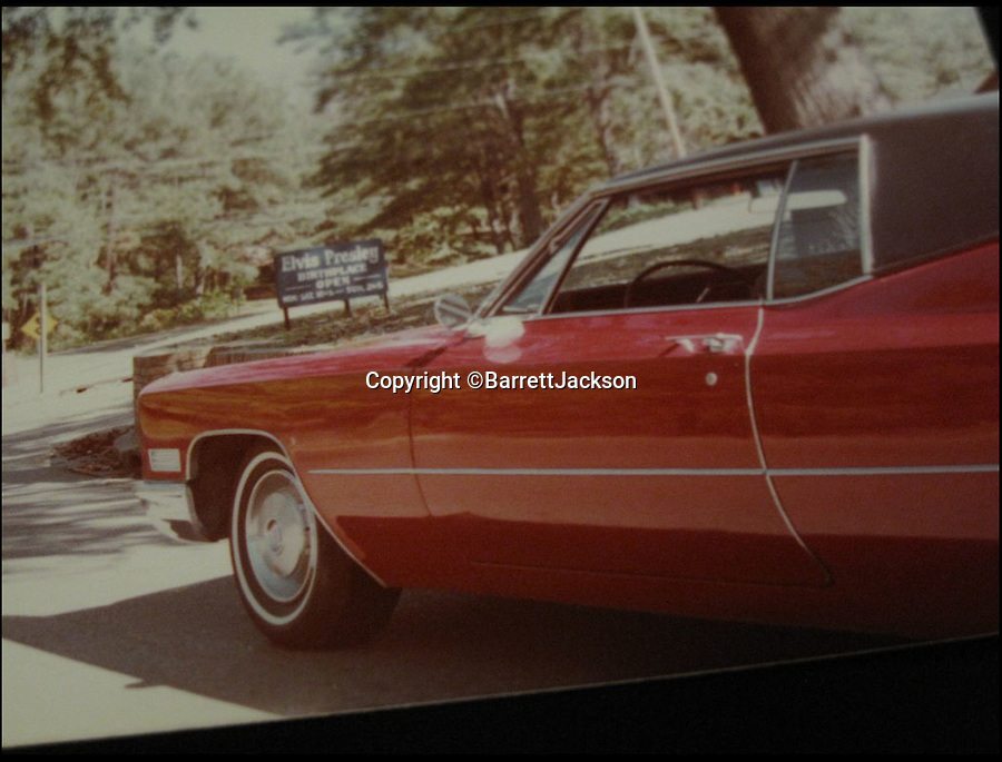 BNPS.co.uk (01202 558833)<br /> Pic: BarrettJAckson/BNPS<br /> <br /> ***Please Use Ful Byline***<br /> <br /> An old photograph of Elvis Preserly's Cadillac. <br /> <br /> A plush red Cadillac which Elvis Presley bought to drive on his honeymoon with Priscilla has sold for a whopping 55,000 pounds.<br /> <br /> The King snapped up the bright red motor after marrying wife Priscilla in Las Vegas on May 1, 1967 and the pair were often seen driving it around Memphis, home to Elvis' legendary Graceland mansion.<br /> <br /> The couple, who were married for six years, also used to drive the car to Elvis' 163-acre Circle G ranch in Mississippi where they spent some of their honeymoon.<br /> <br /> The 1967 Cadillac Coupe de Ville was bought by a private collector at a sale in Las Vegas held by classic car auctioneers Barrett Jackson.