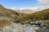 BNPS.co.uk (01202 558833)<br /> Pic: GeoffAllan/BNPS<br /> <br /> Walking along the Bridge of Orchy hills above Rannoch Moor.<br /> <br /> Wilderness walks - new book takes you down paths less travelled in the beautiful Scottish highlands.<br /> <br /> The stunning photos reveal Scotland's best remote walks, and also provide a rudimentary roof over your head at the end of the day. <br /> <br /> Geoff Allan has spent over 30 years travelling the length and breadth of the scenic country, passing through idyllic and untouched landscapes.<br /> <br /> The routes he has selected feature secret beaches, secluded glens, hidden caves and mountains.<br /> <br /> They also include bothies - remote mountain huts - which provide overnight shelter in the wilderness.<br /> <br /> Geoff has listed his top 28 trails complete with GPS maps and descriptions in his book Scottish Bothy Walks.