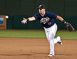 Reno Aces first baseman Mike Jacobs flips the ball to the pitcher covering first against the Round Rock Express during their game on Thursday night August 16, 2012 at Aces Ballpark in Reno NV.