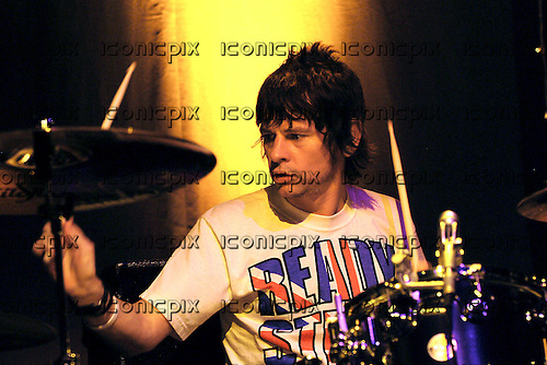 OASIS - Zak Starkey - performing live in concert at the Astoria in London UK - 10 May 2005.  Photo credit: George Chin/IconicPix