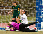 MIDDLETOWN, CT-111817JS27- Holy Cross' Tori Schaffner makes a diving save in front of Old Lyme's Grace Lathrop (8) and teammate Madison Bushka (13), during their Class S state final game Saturday at Middletown High School.<br /> Jim Shannon Republican-American