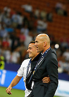 Calcio, finale di Champions League: Real Madrid vs Atletico Madrid. Stadio San Siro, Milano, 28 maggio 2016.<br /> Real Madrid's player Isco, left, and coach Zinedine Zidane celebrate at the end of the Champions League final match against Atletico Madrid, at Milan's San Siro stadium, 28 May 2016. Real Madrid won 5-4 on penalties after the game ended 1-1.<br /> UPDATE IMAGES PRESS/Isabella Bonotto