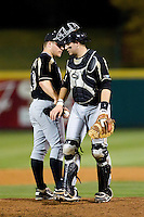 Kevin Plawecki (26) of the Purdue Boilermakers walks back to home plate after a conference on the mound during a game against the Missouri State Bears at Hammons Field on March 13, 2012 in Springfield, Missouri. (David Welker / Four Seam Images)