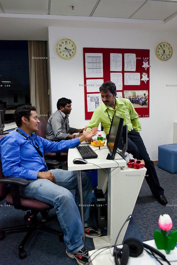 The SUS (Service Unit Support) team sits in the MOC (Management Operational Centre) room. KPN company, Getronics, has off shored multiple business units to the Indian company, Mind Tree in Bangalore, the 'Silicon Valley of India', in the state of Karnataka, India. Photo by Suzanne Lee for Hollandse Hoogte.