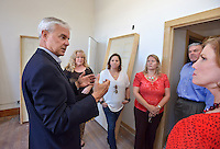 STAFF PHOTO BEN GOFF  @NWABenGoff -- 09/22/14 U.S. Rep. Steve Womack, R-Ark., left, talks with a group from Main Street Rogers while touring the City Hall Lofts as part of a walking tour of new businesses in downtown Rogers on Monday September 22, 2014. Other stops included Park Side Public: A Burger Company, which hopes to open in November, and Brick Street Brews, which opened recently.