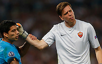 AS Roma's Wojciech Szczesny  hits Barcellona's Luis Suarez during the Champions League Group E soccer match  at the Olympic Stadium in Rome September 16, 2015