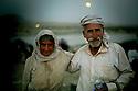 Iraq 2014   August 10, a Yezidi couple , exhausted, arriving in Kurdistan after crossing Pesh Kabur's bridge <br /> <br /> Irak 2014 10 aout, ext&eacute;nu&eacute;s, un couple de Yezidis venant de franchir le pont de Pesh Kabur arrivent au Kurdistan irakien.<br /> <br /> عیراق 2014 ، 10 ی ئاگوست، ژن و مردی ئیزه دی ماندوو ، پردی پیش کابووریان دا هه ر ئیستا تیپه رینه وه و گه یشتوته نه وه کوردستانی عیراق