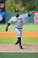 Pitcher Rony Bautista (40) of the Charleston RiverDogs delivers a pitch in a game against the Greenville Drive on Friday, August 14, 2015, at Fluor Field at the West End in Greenville, South Carolina. Charleston won 6-2. (Tom Priddy/Four Seam Images)