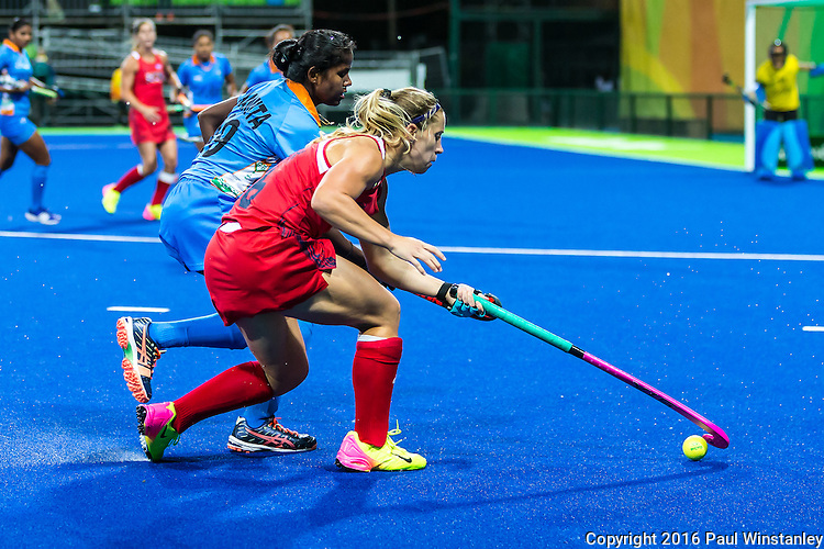 Katie Bam #16 of United States gathers control of the ball while Namita Toppo #19 of India challenges during USA vs India in a women's Pool B game at the Rio 2016 Olympics at the Olympic Hockey Centre in Rio de Janeiro, Brazil.
