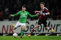 FUSSBALL   1. BUNDESLIGA   SAISON 2011/2012   23. SPIELTAG SV Werder Bremen - 1. FC Nuernberg                   25.02.2012 Francois Affolter (li, SV Werder Bremen) gegen Tomas Pekhart (re, 1 FC Nuernberg)