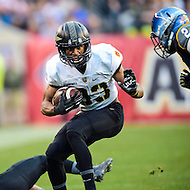 PHILADELPHIA, PA. - DEC 12 2015: Army Black Knights running back Grant Escobar (32) breaks a tackle during Army Navy game at Lincoln Financial Field Philadelphia, PA. (Photo by Phil Peters/Media Images International)