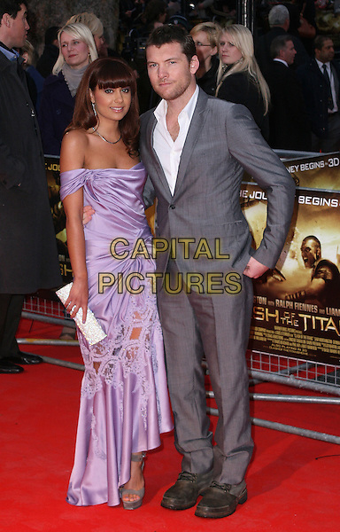 """NATALIE MARK & SAM WORTHINGTON.The """"Clash of The Titans"""" world premiere, Empire cinema, Leicester Square, London, England..March 29th, 2010.full length purple off the shoulder silk satin cut out lace open toe platform shoes sandals dress clutch bag grey gray suit white shirt hand in pocket couple lilac .CAP/JIL.©Jill Mayhew/Capital Pictures"""
