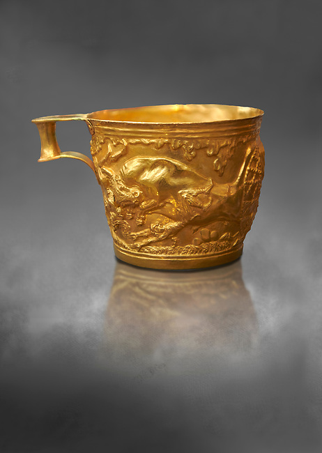 Vapheio type Mycenaean gold cup depicting a wild bull hunt side C , Vapheio Tholos Tomb, Lakonia, Greece. National Archaeological Museum of Athens.   Grey Art Background<br /> <br />  Two masterpieces of Creto - Mycenaean gold metalwork were excavated from a tholos tomb near Lakonia in Sparta in 1988. Made in the 15th century BC, the gold cups are heavily influenced by the Minoan style that was predominant in the Agean at the time. The bull hunt was popular with  Mycenaean  and Minoan artists and symolised power and fertility. The distinctive shape of the cup is kown as 'Vapheio type'.