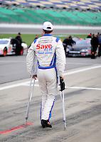 Oct. 3, 2009; Kansas City, KS, USA; NASCAR Nationwide Series driver Carl Edwards walks with crutches during qualifying for the Kansas Lottery 300 at Kansas Speedway. Mandatory Credit: Mark J. Rebilas-