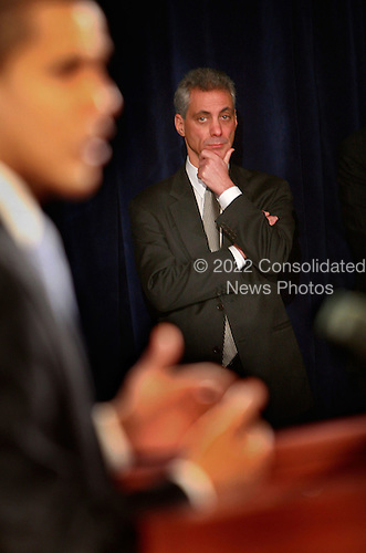 Chicago, IL - December 18, 2008 -- Chief of Staff-designate Rahm Emanuel listens as United States President-elect Barack Obama introduces Mary Schapiro, CEO of the Financial Industry Regulatory Authority (FINRA), as his choice to head the U.S. Securities and Exchange Commission (SEC), Gary Gensler to head the Commodities Futures Trading Commission (CFTC), and named Daniel Tarullo to the Federal Reserve Board of Governors during a press conference at the Drake Hotel December 18, 2008 in Chicago, Illinois. .Credit: Scott Olson - Pool via CNP
