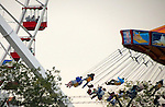 Chicago scenes:  Children and adults enjoy the ferris wheel and amusement rides on the Navy Pier, Streeterville neighborhood in Chicago, Il. (Photo by Jamie Moncrief)