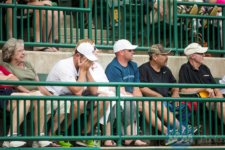 19 MAY 2015:  Andy Roddick, brother of Oklahoma Head Coach John Roddick, buies his face in his hands after an Oklahoma loss during The Division I Men's Tennis Championship, held at the Hurd Tennis Center on the Baylor University campus in Waco, TX.  Virginia defeated Oklahoma 4-1 to win the team national title.  Darren Carroll/NCAA Photos