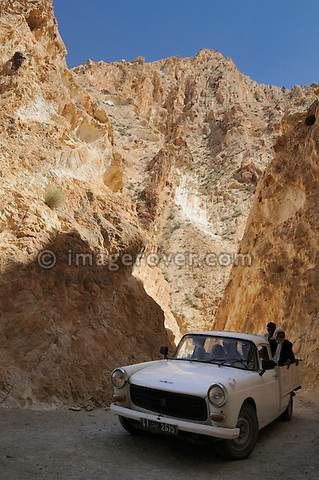 Africa, Tunisia, nr. Saket. Local Peugeot 404 ascending through the famous narrow gorge south of Saket. --- No releases available, but releases may not be needed for certain uses. Automotive trademarks are the property of the trademark holder, authorization may be needed for some uses.  --- Info: Image belongs to a series of photographs taken on a journey to southern Tunisia in North Africa in October 2010. The trip was undertaken by 10 people driving 5 historic Series Land Rover vehicles from the 1960's and 1970's. Most of the journey's time was spent in the Sahara desert, especially in the area around Douz, Tembaine, Ksar Ghilane on the eastern edge of the Grand Erg Oriental.