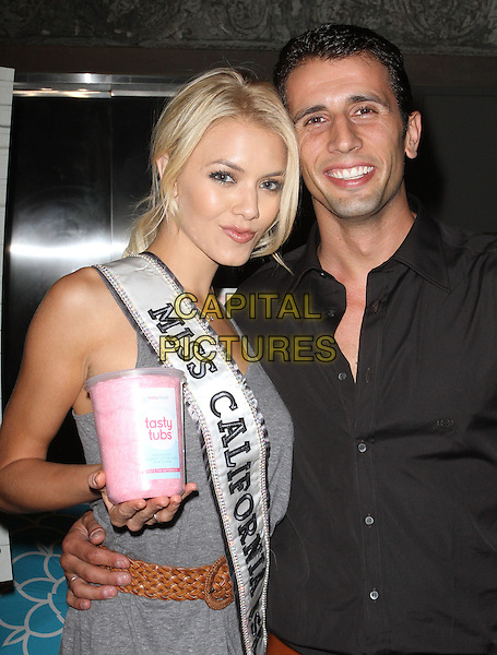 Miss California 2011 Katie Blair & guest.Beach Bunny Grand Opening Party Held At Malibu Lumber Yard, Malibu, California, USA..August 18th, 2011.half length grey gray sash hand on hip dress belt brown tasty tubs black shirt .CAP/ADM/KB.©Kevan Brooks/AdMedia/Capital Pictures.