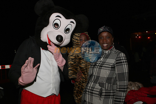 Mickey Mouse with Ronard and Bukky Wirson as Santa arrives in Dunleer...Photo NEWSFILE/Jenny Matthews..(Photo credit should read Jenny Matthews/NEWSFILE)