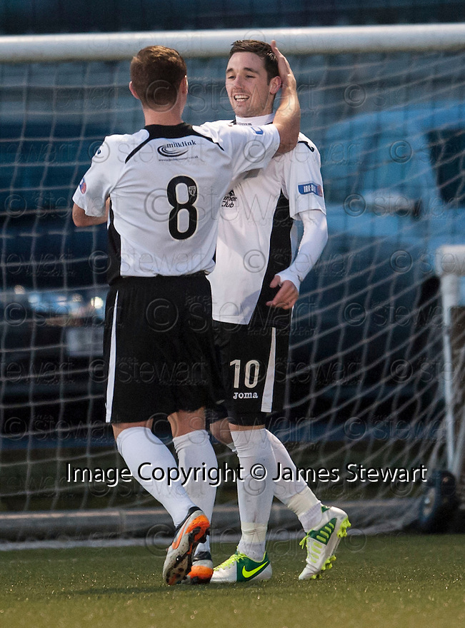 Queen of the South's Nicky Clark is congratulated by Chris Mitchell after he scores their second goal.