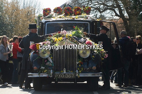Jade Goody Funeral April 4 2009. TV Reality Star funeral service well wishers gather outside St Johns Chuch Buckhurst Hill Essex England. Rollys Royce hearst covered in flowers.