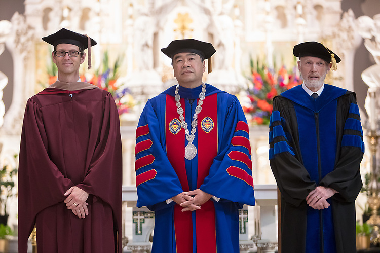 Left to right, Jeff Bethke, executive vice president, DePaul University President A. Gabriel Esteban, Ph.D., and Marten denBoer, provost, stand as faculty and staff enter into the St. Vincent de Paul Parish Church for the annual Academic Convocation ceremony, Thursday, Aug. 31, 2017, on the Lincoln Park Campus. (DePaul University/Jeff Carrion)