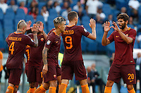 Calcio, Serie A: Roma vs Udinese. Roma, stadio Olimpico, 20 agosto 2016.<br /> Roma&rsquo;s Edin Dzeko, second from right, celebrates with teammates after scoring during the Italian Serie A football match between Roma and Udinese at Rome's Olympic stadium, 20 August 2016. Roma won 4-0.<br /> UPDATE IMAGES PRESS/Riccardo De Luca