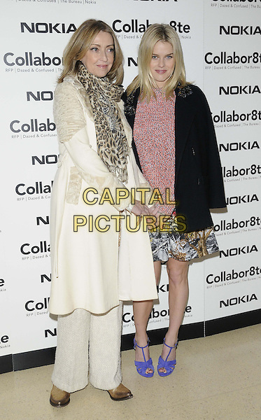 "Sharon Maughan & Alice Eve.The ""Collabor8te"" VIP film screening, Regent Street Cinema, University of Westminster, Regent St., London, England..February 12th, 2013.full length black jacket pink top sweater jumper skirt pattern purple shoes over shoulder white cream coat brown leopard print scarf mother mom mum daughter family .CAP/CAN.©Can Nguyen/Capital Pictures."