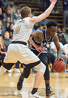NWA Democrat-Gazette/CHARLIE KAIJO Springdale Har-Ber High School Austin Garrett (1) dribbles past Bentonville High School Michael Shanks (11) during a basketball game on Friday, January 12, 2018 at Bentonville High School in Bentonville.