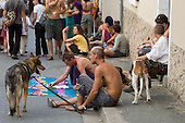 Street vendors with dogs at the 31st International Festival of Luthiers and Maitres Sonneurs, in Saint Chartier, France.