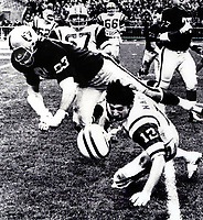Raiders Ben Davidson hits New York Jets Joe Namath.(Russ Reed photo)