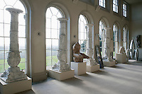 A collection of columns and other pieces of sculpture is displayed in the neo-classical orangery
