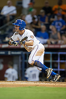 Boog Powell (2) of the Durham Bulls drags a bunt down the first base line during the game against the Indianapolis Indians at Durham Bulls Athletic Park on August 4, 2015 in Durham, North Carolina.  The Indians defeated the Bulls 5-1.  (Brian Westerholt/Four Seam Images)