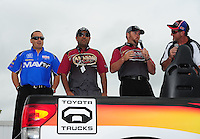Jun. 1, 2012; Englishtown, NJ, USA: NHRA top fuel dragster drivers (L-R) Brandon Bernstein, Khalid Albalooshi amd Shawn Langdon talk to a Toyota team member during qualifying for the Supernationals at Raceway Park. Mandatory Credit: Mark J. Rebilas-