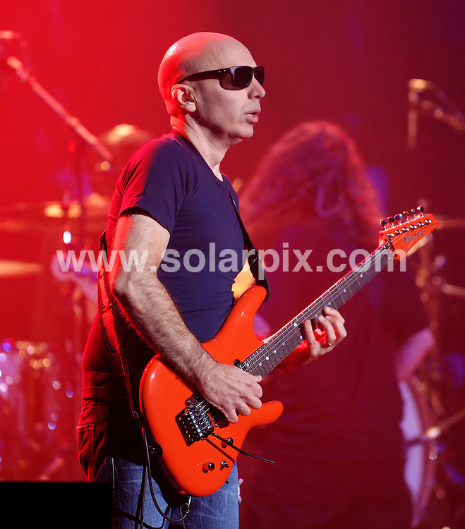 **ALL ROUND PICTURES FROM SOLARPIX.COM**                                             **WORLDWIDE SYNDICATION RIGHTS**                                                                                  Caption: Joe Satriani live in concert at the Manchester Apollo, Manchester, UK. 17 October 2010                                                                              This pic: Joe Satriani                                                                                             JOB REF: 12333 SGD       DATE: 17_10_2010                                                           **MUST CREDIT SOLARPIX.COM OR DOUBLE FEE WILL BE CHARGED**                                                                      **MUST AGREE FEE BEFORE ONLINE USAGE**                               **CALL US ON: +34 952 811 768 or LOW RATE FROM UK 0844 617 7637**