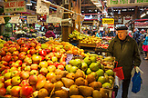 CANADA, Vancouver, British Columbia, elderly man in a beret shops for produce in the Granville Island Public Market