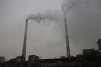 Smoke bellows out from a power plant chimney in Chongqing, China..17 Oct 2007