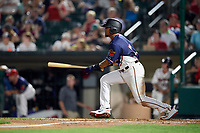 Rochester Red Wings left fielder LaMonte Wade (11) follows through on a swing during a game against the Pawtucket Red Sox on July 4, 2018 at Frontier Field in Rochester, New York.  Pawtucket defeated Rochester 6-5.  (Mike Janes/Four Seam Images)