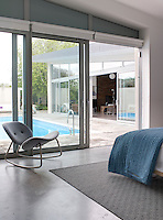 The master bedroom opens directly onto the swimming pool terrace