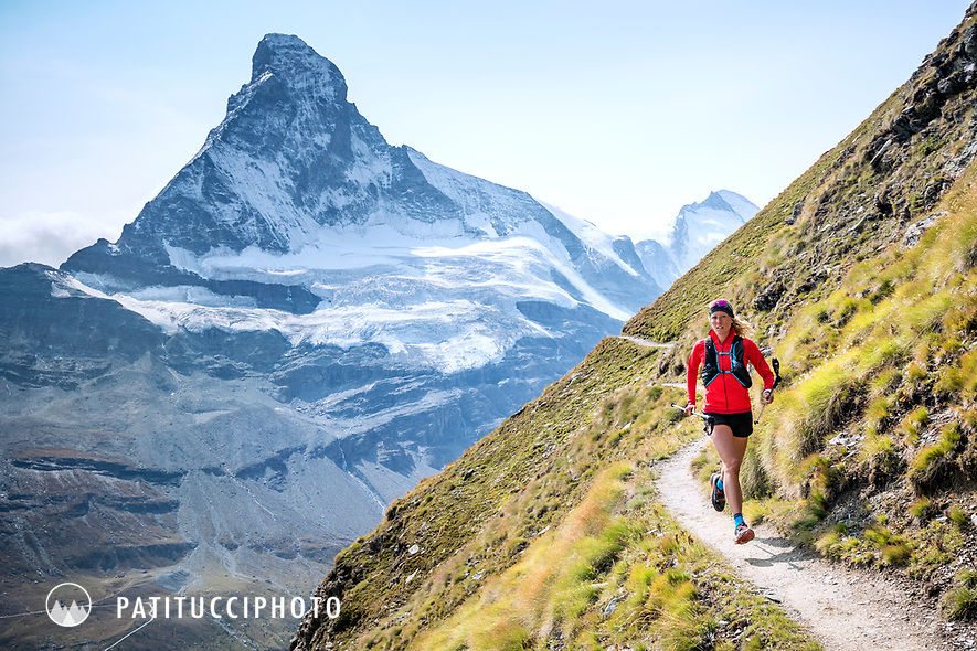 Trail running above Zermatt, Switzerland with the Matterhorn in the distance.