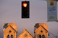 Santa Fe, N.M. is celebrating its 400th birthday this year. The sun sets on the steeples of the 19th-century St. Francis Cathedral. (Kevin Moloney for the New York Times)